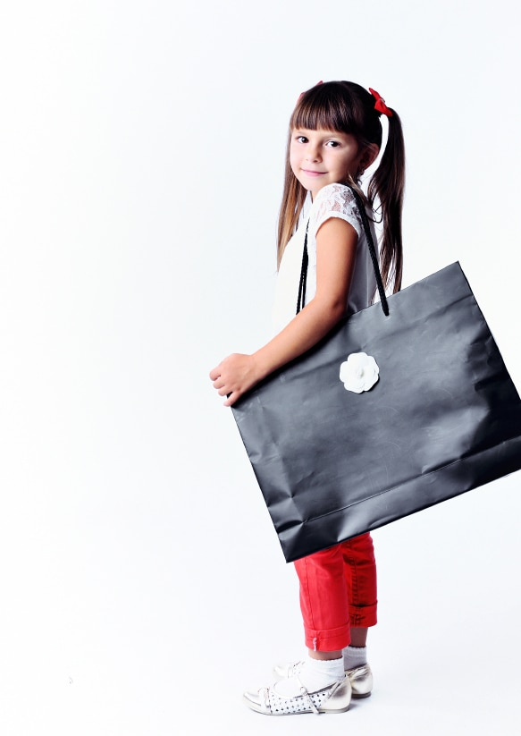 Little girl with a big bag for shopping